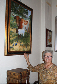 Artist Marquita Priest showed her painting Texas Pride at the Spring Arts Festival.