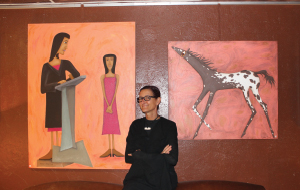 Cisco Tucker Kolkmeier with her acrylic on canvas paintings The Judge and Eli.