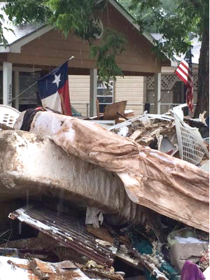 The aftermath of the Brazos River flooding outside of a Rosenberg home. Photo by Second Mile Mission.