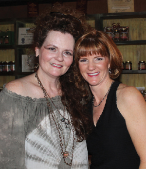 Patti Parish-Kaminski and Kim Cress at the July absolutely! Brazos Cover Party at BR Vino in Historic Downtown Rosenberg.
