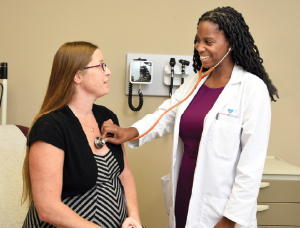 Patient Melissa Taylor and Kamilah Dixon-Shambley, MD, MA.