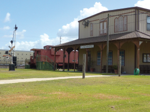The Rosenberg Railroad Museum Gallery is a reproduction of the Rosenberg Santa Fe Depot with the 1972 MoPac Caboose in the background.