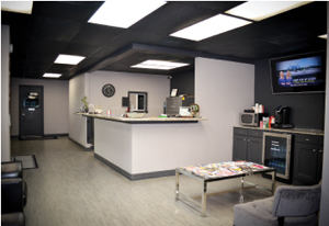 Expert Collision Center boasts a welcoming front desk and waiting area for customers.